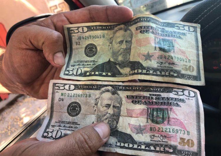 """Alertan de """"pochos"""" que pagan con billetes de 50 dólares falsos"""