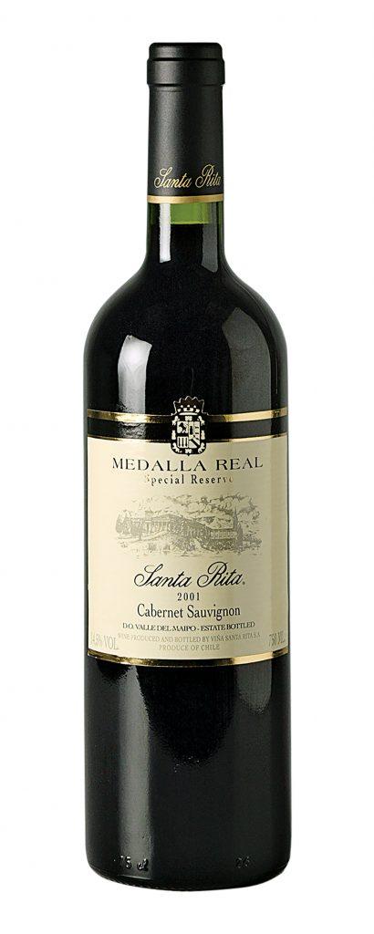 Botella de vino negra con verde oscuro y etiqueta blanca con dorado