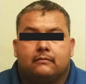 Arrestan a policía municipal acusado de homicidio