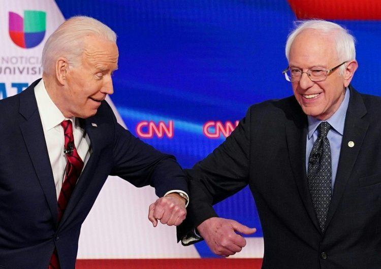 Biden y Sanders se atacan por el pasado pero se unen contra Trump