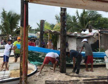 Pescadores se preparan para tormenta