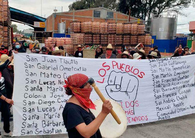 Pobladores de Juan C. Bonilla irrumpen en Bonafont y hacen daños
